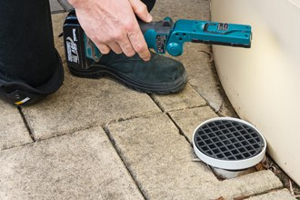 Looking for blockages in drain
