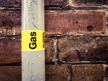 Gas pipe outside on brick wall