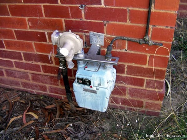 Gas metre outside on brick wall